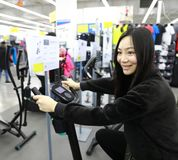 Woman in Indoor bycicle cycling in gym. Competition, caucasian. Woman people spinning in the gym, exercising their legs doing cardio training at shanghai Royalty Free Stock Images