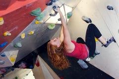 Woman Indoor Free Climbing Stock Image