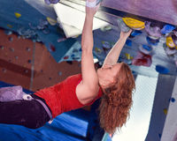 Woman Indoor Free Climbing Stock Image