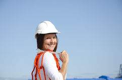 Woman industrial worker sky background Stock Images