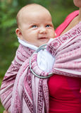 Woman with infant in sling Royalty Free Stock Photography
