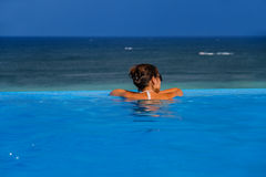 Woman in the infinity pool stock image