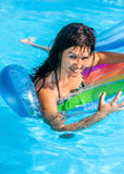 Woman on inflatable beach mattress Stock Image