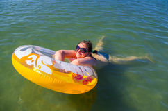 Woman on the inflatable buoy Royalty Free Stock Photography
