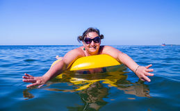 Woman on the inflatable buoy Royalty Free Stock Photo