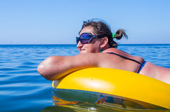 Woman on the inflatable buoy Stock Photography