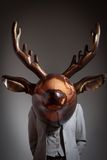 Woman with an inflatable deer head Royalty Free Stock Photo