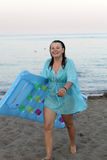 Woman with inflatable mattress on beach Royalty Free Stock Photo