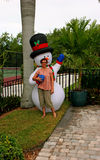 Woman with inflatable snowman Stock Images