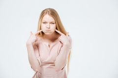Woman with inflated cheeks Royalty Free Stock Image