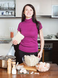 Woman with ingredients for cooking  noodles with seafood Stock Photo