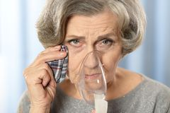 Woman with inhaler Stock Images