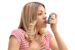 Woman inhaling her asthma medication Royalty Free Stock Photography