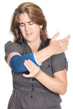 Woman with injured elbow using an elastic support Royalty Free Stock Photos