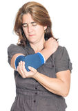 Woman with injured elbow using an elastic support Royalty Free Stock Photography