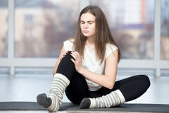 Woman injured her knee during sport exercise Stock Photo