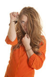 Woman inmate cuffs messed up hair sad Stock Photo
