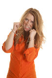 Woman inmate cuffs messy hair bite chain Stock Photography