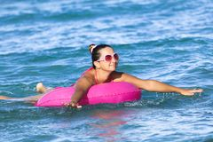 Woman on inner tube Stock Images