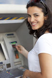 Woman inserts card in the ATM Royalty Free Stock Image