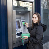 Woman at ATM Stock Photography