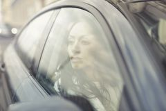 Woman Inside the Black Sedan at Daytime Royalty Free Stock Image