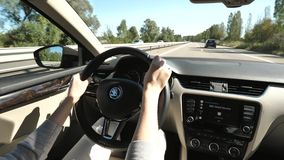 Woman inside car Skoda electric vehicle Skoda logo. Alsace, France - Circa 2018: Point of view woman driving electric Skoda car - view car interior to the road stock video footage