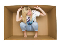Woman inside a Cradboard Box. Young woman inside a Cardboard Box isolated on white Stock Photo