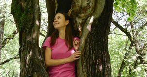 Woman inside a large tree stock video footage