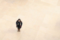 A woman inside the Louvre Museum (Musee du Louvre) Royalty Free Stock Image
