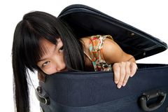 Woman inside luggage Stock Images