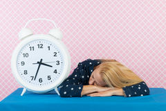 Woman with insomnia and big alarm clock Royalty Free Stock Photos