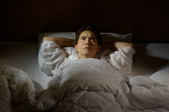 Woman with insomnia. Lying in bed with open eyes Royalty Free Stock Photos