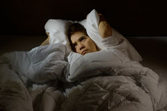 Woman with insomnia. Lying in bed with open eyes Royalty Free Stock Images