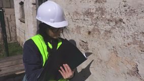 Woman inspect the old wall. In summer day stock video