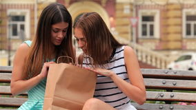 Woman inspecting content of paper bags stock footage