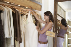 Woman Inspecting Dress Stock Photo
