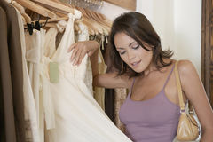 Woman Inspecting Dress Royalty Free Stock Image