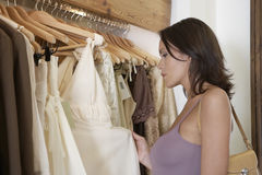 Woman Inspecting Dress Royalty Free Stock Photography