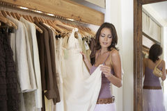 Woman Inspecting Dress Stock Photography