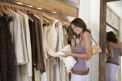 Woman Inspecting Dress Royalty Free Stock Photos