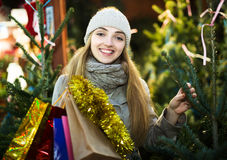 Woman inspecting fir trees Royalty Free Stock Photography