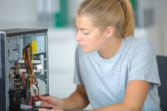 Woman inspecting the motherboard Stock Image