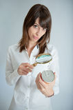 Woman inspecting nutrition label Royalty Free Stock Photo