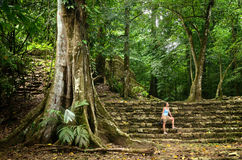 A woman inspects less studied archaeological structures in the j Royalty Free Stock Images