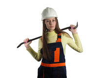 The woman with the installer tool. The beautiful girl dressed in overalls with claw hammer Royalty Free Stock Photos