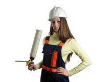 The woman with the installer tool. The beautiful girl dressed in overalls with construction foam Royalty Free Stock Photo