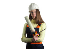 The woman with the installer tool. The beautiful girl dressed in overalls with construction foam Royalty Free Stock Photography