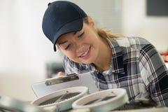 Woman installing new hob in modern kitchen. Woman installing a new hob in modern kitchen stock images