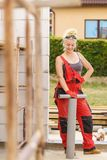 Woman installing pipes on construction site stock photos